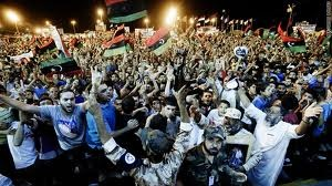 Libyans celebrate the routing of Gaddafi