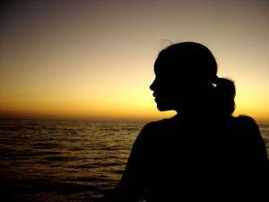 Young-woman-staring-at-the-sea
