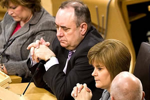 Glum chums: Alex Salmond and Nicola Sturgeon are heading for annihilation come 2014
