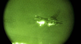 Patrolling the night sky: An allied fighter jet flies low over Libya
