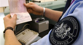 The UK border: A border patrolman checks a passport