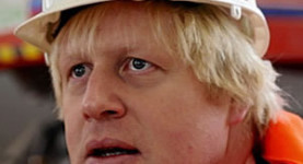 Boris Johnson wears a hard hat, knowing what