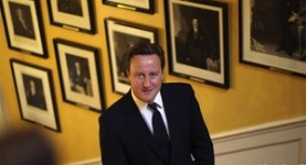 Euro flop: Mr Cameron, flanked by images of better prime ministers
