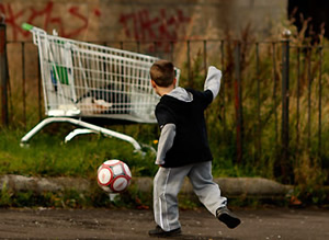 POLITICAL ANALYSIS: The child represents child poverty, the ball represents the Labour child poverty targets, and the shopping trolley represents Tesco, one of the many employers whose low wages are hurting the country.