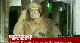 Insane: Colonel Muammadman Gaddafi makes a deranged speech as the walls close in