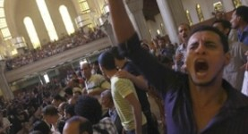 Persecuted by hate: Egyptian Coptics at the funeral for some of the 24 killed