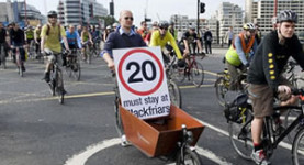 When politics and cycling meet, you get... cycles-with-sign-man!