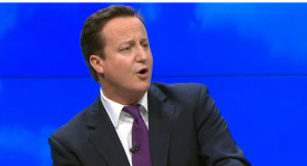 Leading on the global stage: David Cameron delivering his speech to the Conservative party conference today