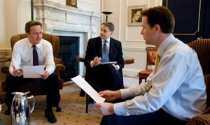 Singing from the same hymn sheet: David Cameron and Nick Clegg discuss how to cut taxes and slash spending