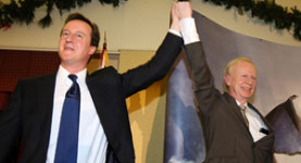 Happier days: David Cameron and Sir Reg Empey celebrate their link together