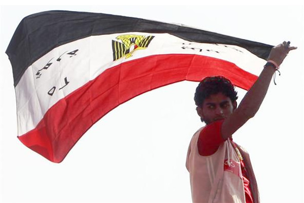 Tahrir Square, Cairo: A demonstrator protests after Friday prayers, demanding democracy