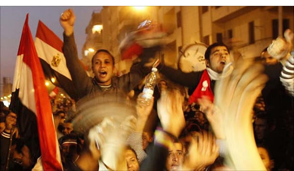 Victory! Egyptians celebrate the resignation of President Mubarak