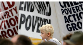 "Campaigning for children: A child at an ""End Child Poverty"" march"