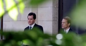 George Osborne and David Laws wield the axe in the Treasury Atrium this morning