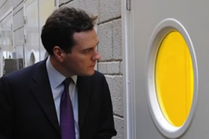 Osborne stares into the room where they keep all the Lib Dems