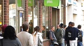 Disastrous: Young people wait outside the Job Centre, with very few vacancies on offer