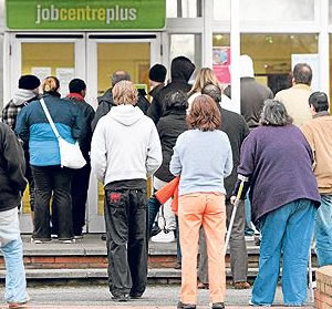 Unemployed people queue to get into a Job Centre Plus