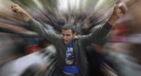 Jubilant: An Egyptian protester - but what was the cost of Egypt
