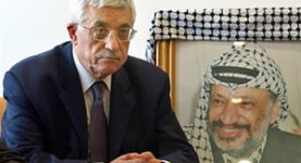 Mahmoud Abbas and a photo of Yasser Arafat