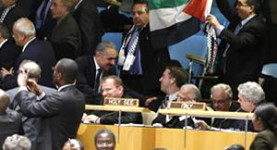 Historic: Palestinian supporters cheer and wave a flag as the Palestine UN vote passed yesterday, 29th November 2012