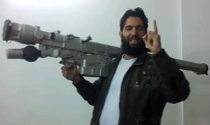 A Syrian rebel with a Surface to Air missile