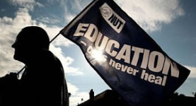 Fighting for their rights: Striking teachers rally in London today