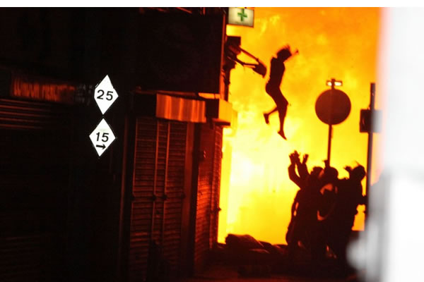 Leaping for her life: A woman jumps to safety from a burning building