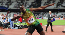 Lightning strikes twice! Usain Bolt celebrates his 100m win at the Anniversary Games is the Stratford Olympic Stadium, London, last night