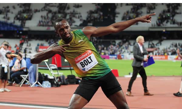 Lightning strikes twice! Usain Bolt celebrates his 100m win at the Anniversary Games is the Stratford Olympic Stadium, London, last night