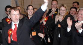 No Bain, no gain: Willie Bain salutes his supporters after victory in the Glasgow North East by-election