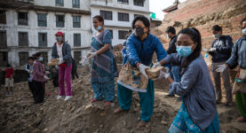 Volunteers saving bricks from destroyed ancient buildings and helping helping Nepalese security forces to excavate ancient carvings and other artefacts at the Patan Durbar Square, a UNESCO World Heritage Site, that was partly destroyed in the earthquake.  On 25 April 2015 a powerful earthquake of 7.8 magnitude struck Nepal, causing widespread destruction and killing approximately 6,507 people and injuring more then 14,000 (May 2nd estimate).