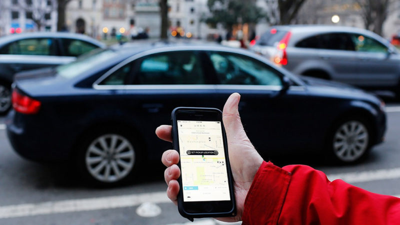 A customer calling an Uber cab by mobile