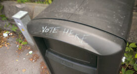 A bin with 'vote here' graffitied onto it