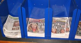 Newspapers in holder