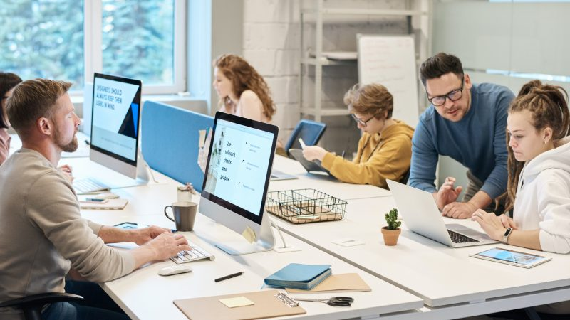 A photo of people working in an office